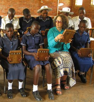 Chinhoyi High School #2 students playing mbiras donated by MBIRA, with Erica Azim 2014