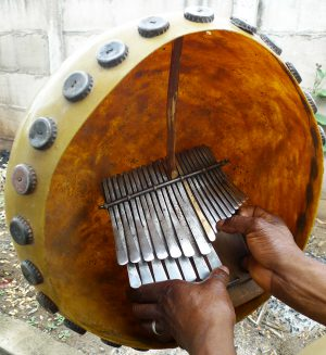 Playing mbira in deze