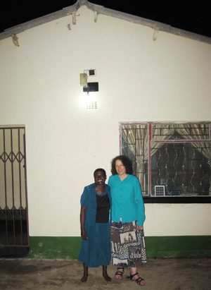 With Erica Azim in Front of the House Patience Built with her 2009 MBIRA Tour Proceeds