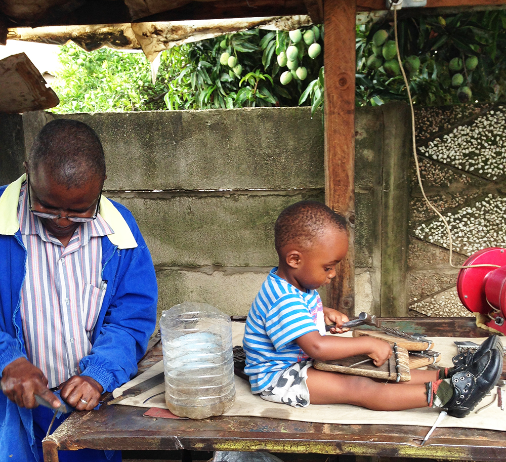 Fradreck Mujuru making mbiras together with his grandson 2014