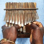 Playing mbira