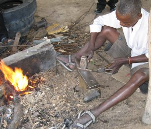 Tembedza pounding red hot steel to make mbira key