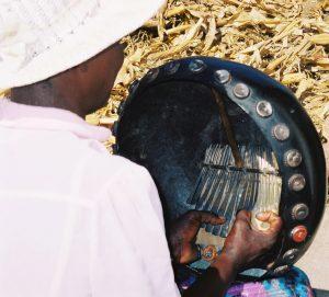 Jenny Muchumi hands on mbira