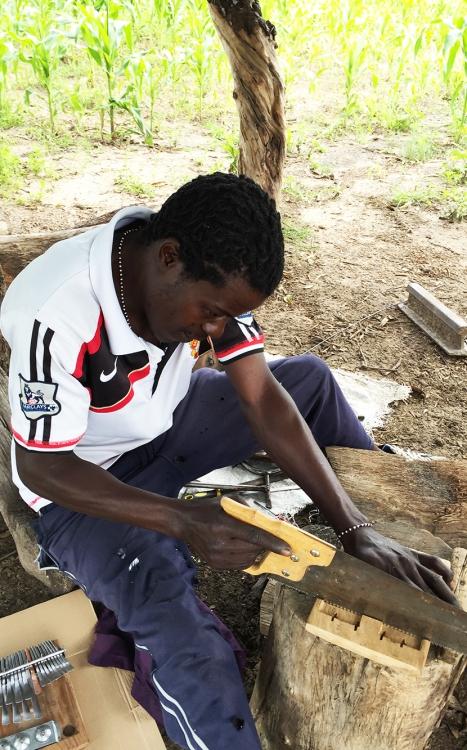 Romeo Mhondiwa sawing