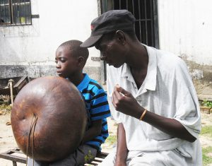 Alois Mutinhiri & son. Musicians who receive MBIRA Musicians Fund donation must also teach mbira to younger musicians in their community.