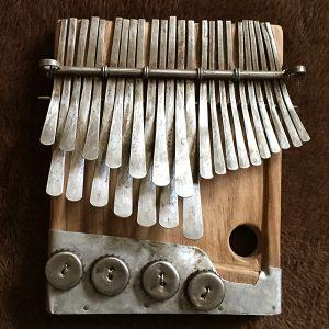 Nyamaropa tuning mbira by Edison Chivese
