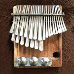 Nyamaropa tuning mbira by Newtan Chihota