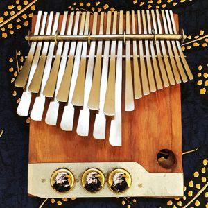 Nyamaropa tuning mbira by Stanley Mujuru