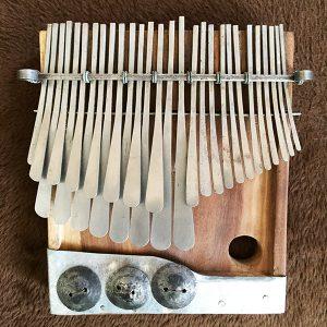Mavembe tuning mbira by Gift Rushambwa