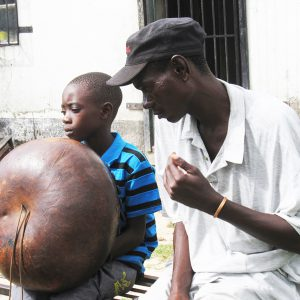 Alois Mutinhiri teaches his son – musicians who teach children receive donations