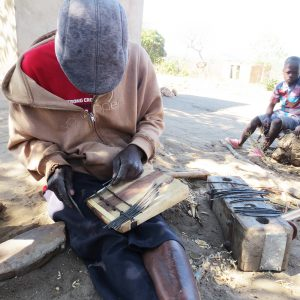 Anthony Zonke repairing matepe